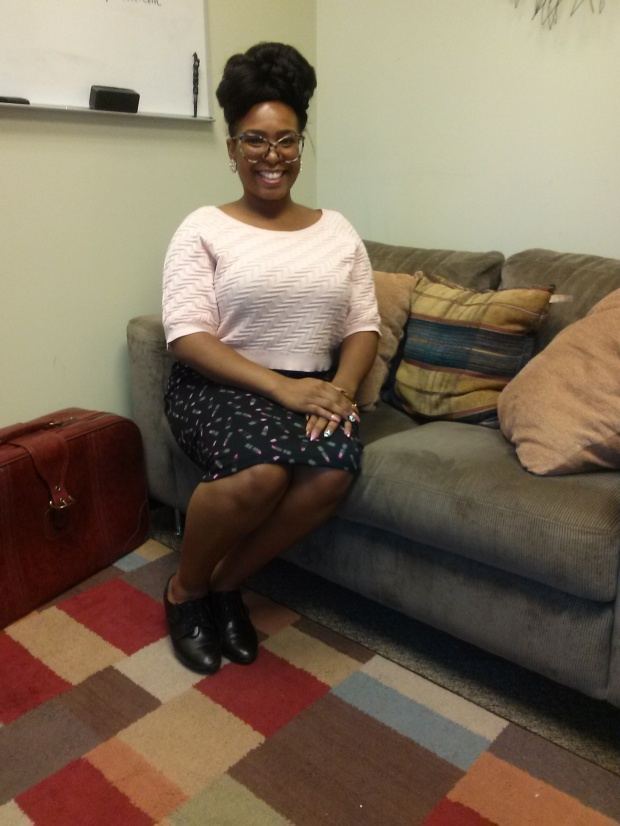 Pictured in my office with one of my favorite work outfits: a crop top sweater with a zig-zag pattern and a pencil skirt with a lipstick pattern.